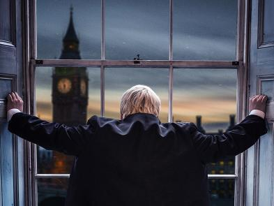Boris Johnson looks out of a window at sunset at Big Ben