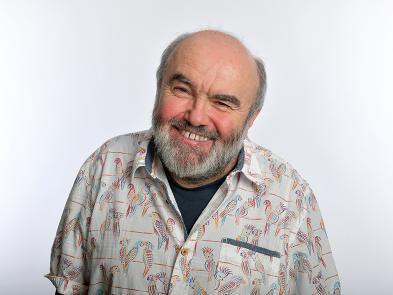 A photo of Andy Hamilton in front of a white background.