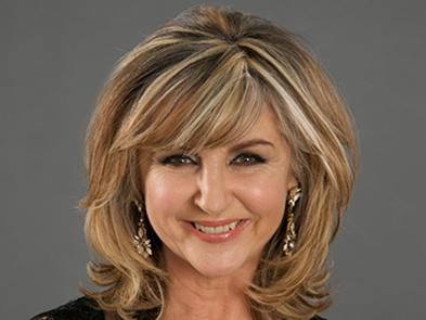 A headshot of Lesley Garrett in front of a grey background.