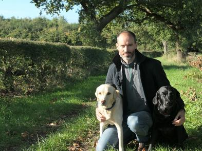 Andrew Cotter with his two dogs