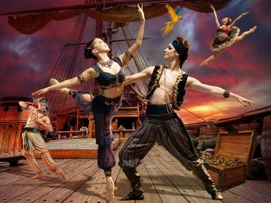 Several pirates dance around a pirate ship in front of a stormy background.